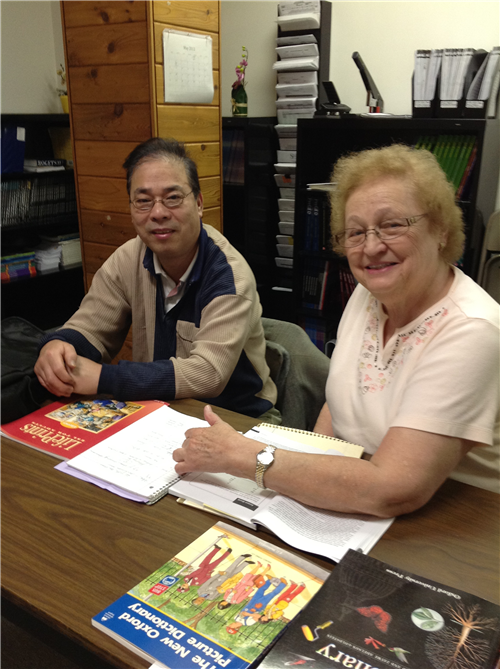 A volunteer tutor working with an adult learner.